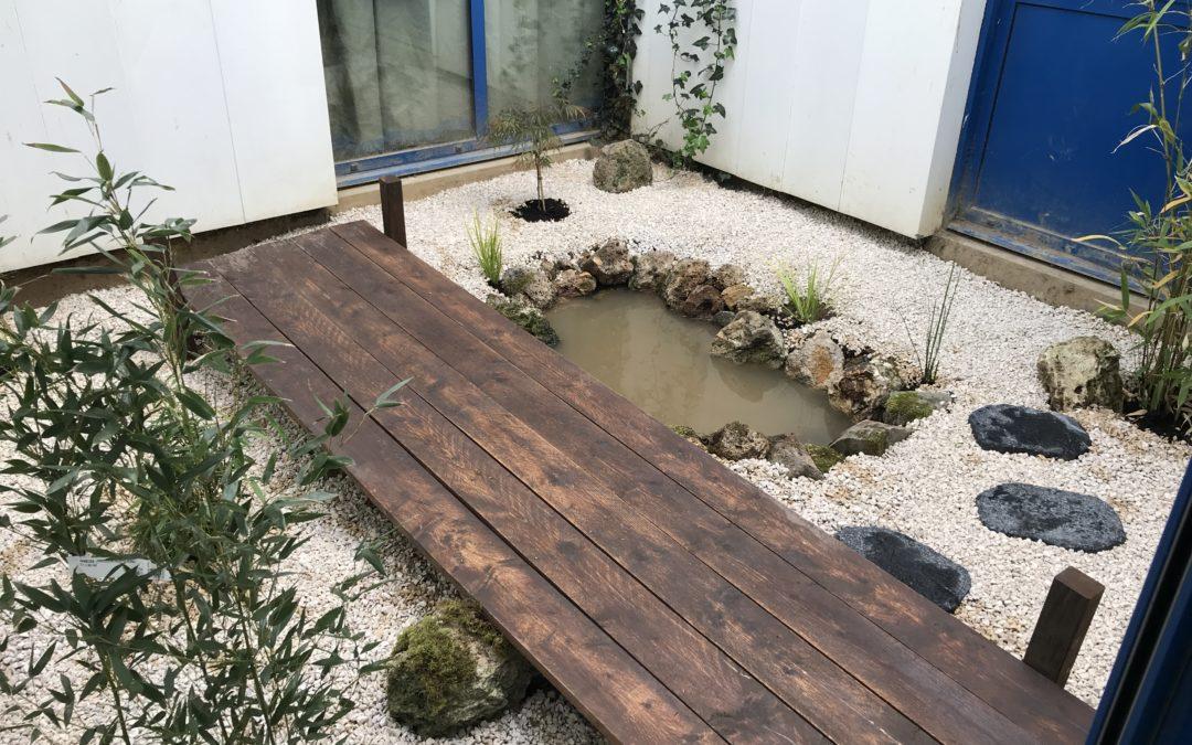 Réalisation d'un jardin japonais avec les enfants de l'école Renoir à Trappes